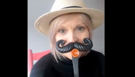 Our Fun Palaces Ambassador wearing a prop moustache