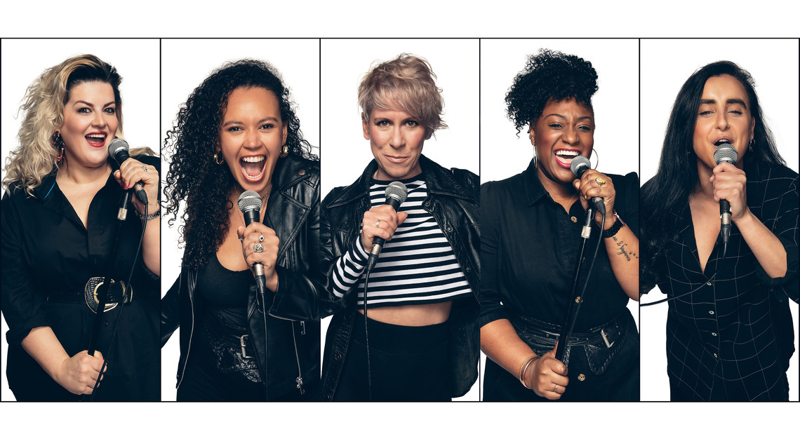 the cast of 5 women each singing into their microphone