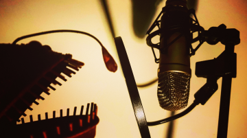 A mouth of a monster speaking into a radio mic.
