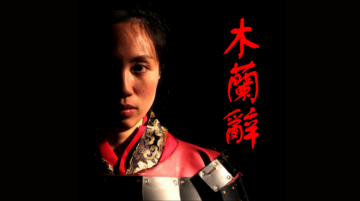 Head and shoulder photo of a woman in traditional Chinese dress.