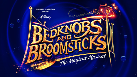 A dark blue background, in front of which is a minimalist and abstract design of a golden bed. In the foreground is the title 'Bedknobs and Broomsticks'
