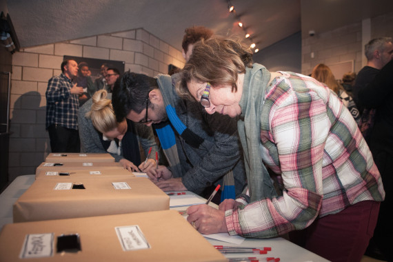 Audiences filling in feedback forms following Sheffield Theatres Making Room Studio takeover event