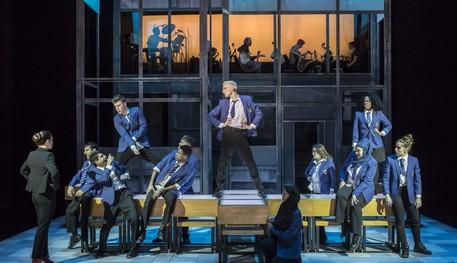 A production image of the cast of Everybody's Talking About Jamie dancing on tables on the Crucible Stage
