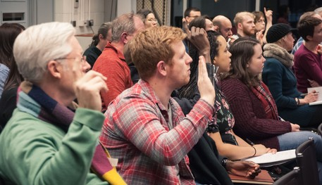 Audience asking questions during a talk at Sheffield Theatres