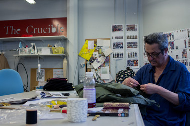 Member of Sheffield Theatres wardrobe department sewing an item of costume